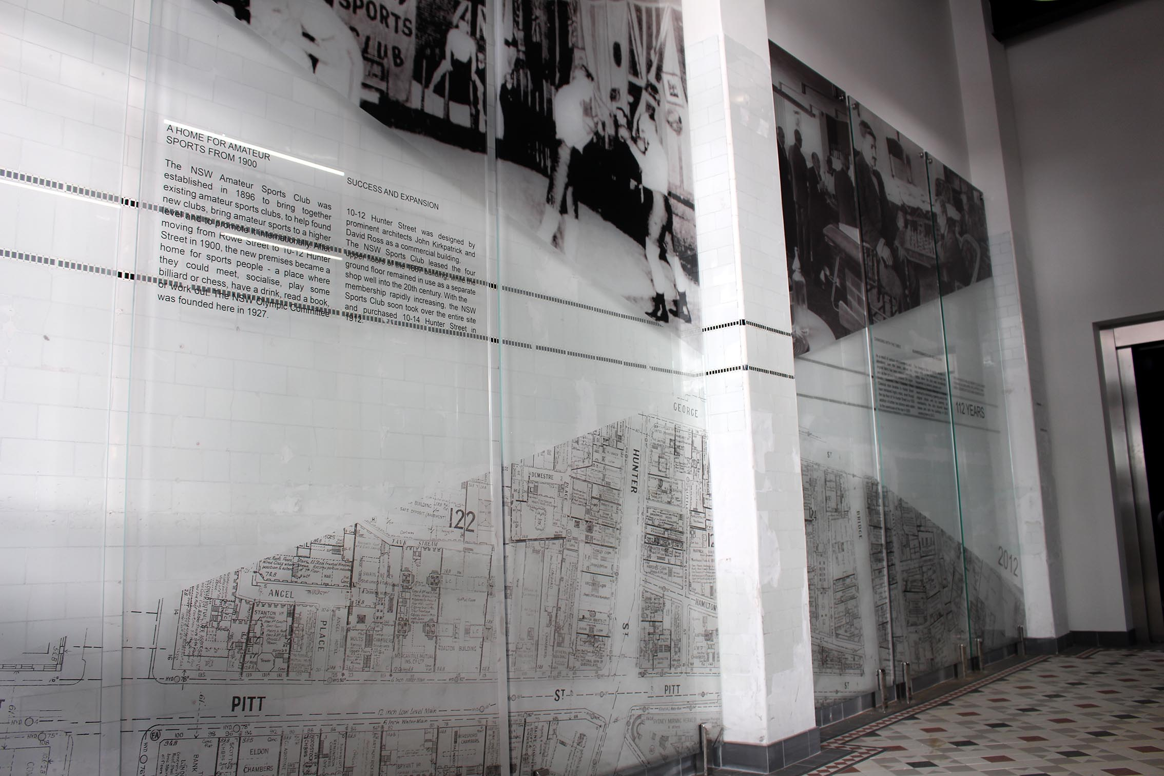 Six large pin mounted glass panels with various black and white images of the NSW Sports club in its heyday.