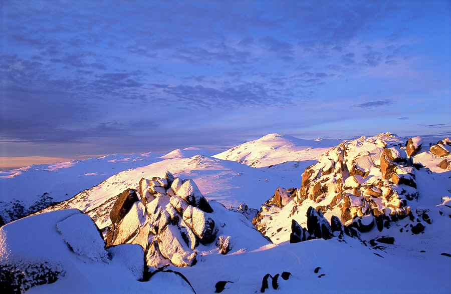 Photograph of a snow capped mountain range
