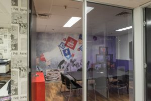 Digitally printed removable self-adhesive wall fabric on an office wall