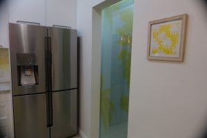 kitchen with a digitally printed translucent laminated sliding pantry door