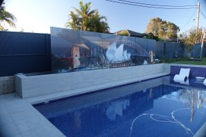 Pool with a 7m wide custom glass digitally printed pool fence