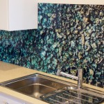 Kitchen glass splashback with ocean water and rock imagery