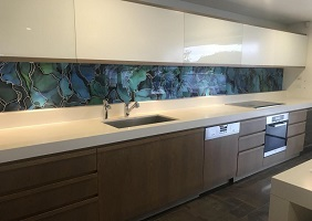 Guide to designing, printing, and installing a custom kitchen glass splashback for your home.