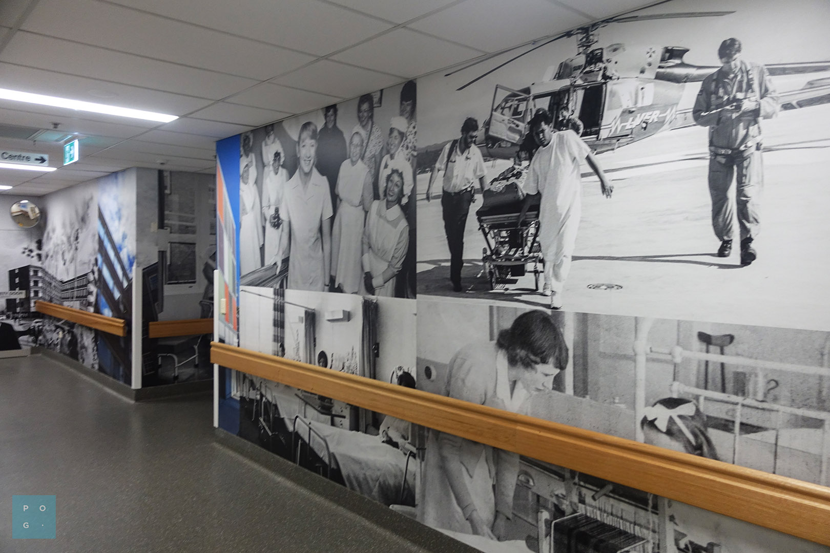 Hospital hallway with custom printed wall graphic panels featuring hospital imagery.