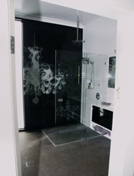 Chandelier design on bathroom glass splashback