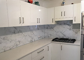 Kitchen glass splashback with printed natural marble image installed in Gosford.